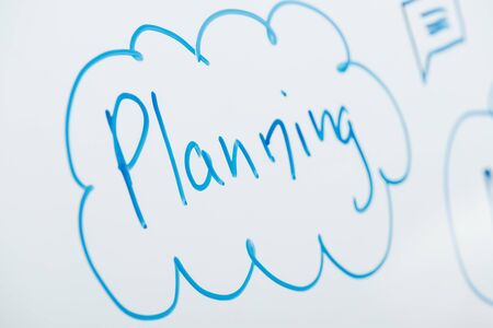 close up view of word planning written on white flipchart