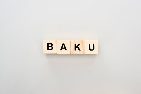 top view of wooden blocks with Baku lettering on grey background