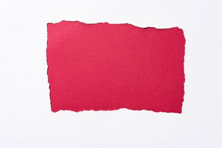 red colorful background in white torn paper hole