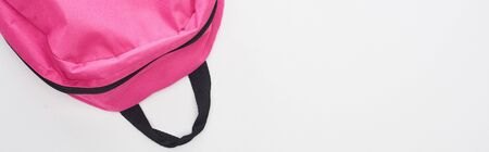 Panoramic shot of bright pink school bag isolated on white Stock Photo