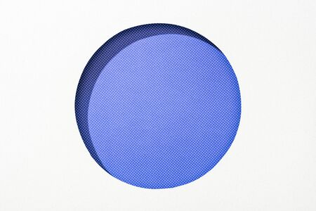 cut out round hole in white paper on purple dotted colorful background