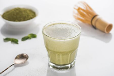 selective focus of green matcha tea on white table Stock fotó