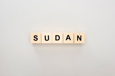 top view of wooden blocks with Sudan lettering on white background