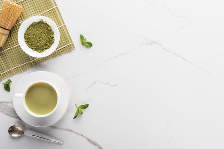 top view of green matcha tea on white table with copy space