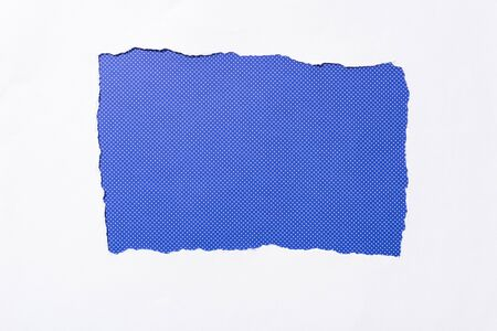 electric blue dotted colorful background in white torn paper hole Banque d'images - 130442494