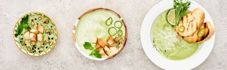 flat lay with delicious creamy green soup served with croutons, panoramic shot