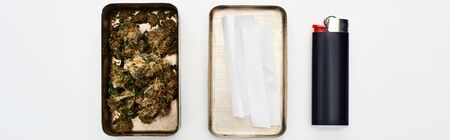 flat lay with metal box with marijuana buds and rolling paper near lighter, panoramic shot Stok Fotoğraf