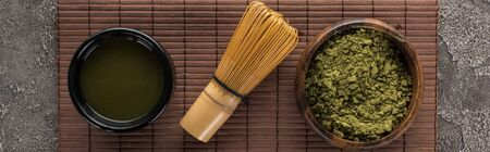 top view of traditional green matcha tea on bamboo mat