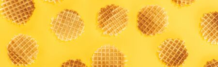 panoramic shot of crispy waffles isolated on yellow