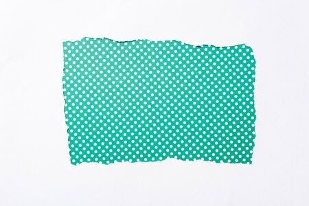 polka dot green and white colorful background in white torn paper hole Banque d'images - 130444180