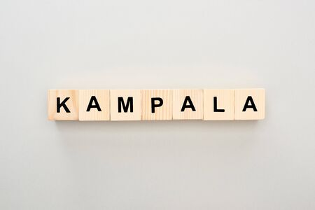 top view of wooden blocks with Kampala lettering on grey background