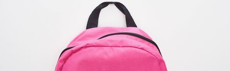 Panoramic shot of closed bright pink school bag isolated on white