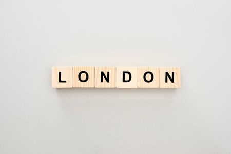 top view of wooden blocks with London lettering on grey background