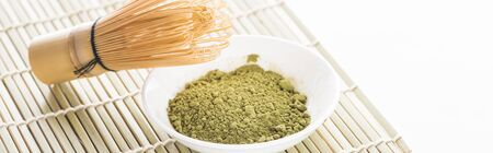 traditional green matcha tea with whisk on bamboo mat