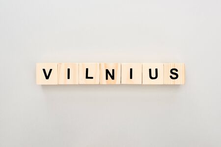 top view of wooden blocks with Vilnius lettering on white background
