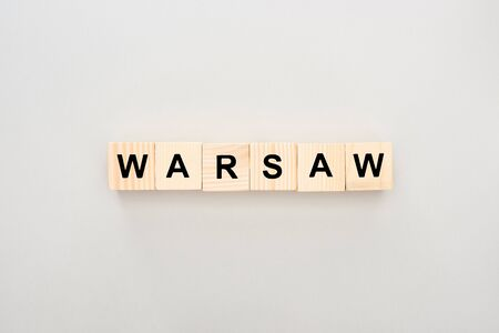 top view of wooden blocks with Warsaw lettering on white background Stock fotó - 130444258