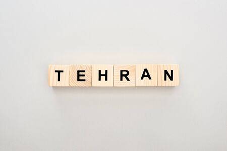 top view of wooden blocks with Tehran lettering on white background Фото со стока