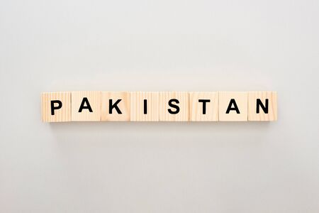 top view of wooden blocks with Pakistan lettering on white background