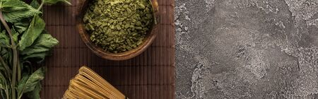 top view of green matcha tea and mint on bamboo mat on dark stone table