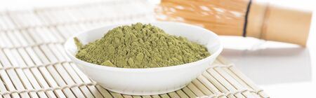 traditional green matcha tea with whisk on bamboo mat Reklamní fotografie - 130443907
