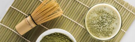 top view of green matcha tea and whisk on bamboo mat Stock fotó