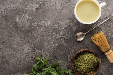 top view of matcha green tea on dark stone table with copy space