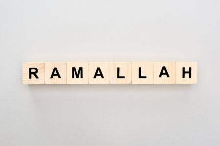 top view of wooden blocks with Ramallah lettering on white background 스톡 콘텐츠