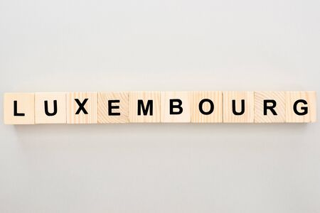 top view of wooden blocks with Luxembourg lettering on white background Stockfoto
