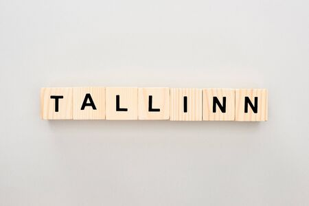 top view of wooden blocks with Tallinn lettering on white background