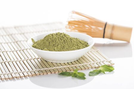 matcha green tea powder with whisk on bamboo mat Reklamní fotografie