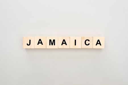 top view of wooden blocks with Jamaica lettering on white background