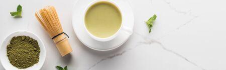top view of green matcha tea on white table Reklamní fotografie