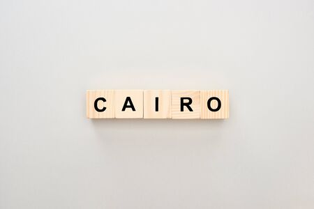 top view of wooden blocks with Cairo lettering on grey background 版權商用圖片