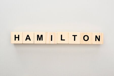 top view of wooden blocks with Hamilton lettering on grey background Stock Photo