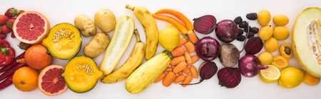 panoramic shot of fresh autumn vegetables and fruits on white background Stock Photo