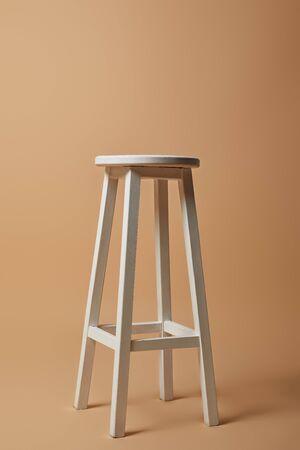 high white chair on beige background