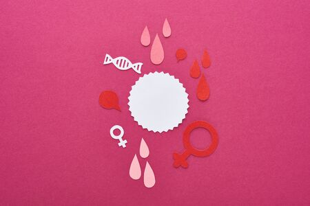 top view of paper cut white empty card with female signs and blood drops on purple background
