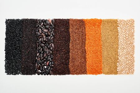 top view of assorted black beans, rice, quinoa, buckwheat, chickpea and lentil isolated on white