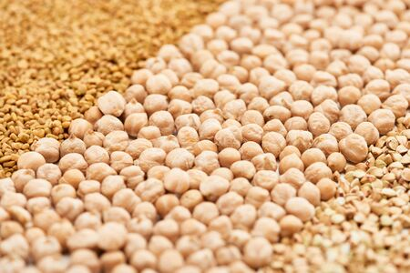 close up view of raw chickpea between assorted grains