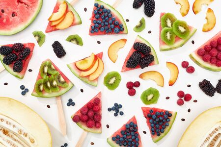 pattern with delicious juicy watermelon on sticks with seasonal berries and fruits
