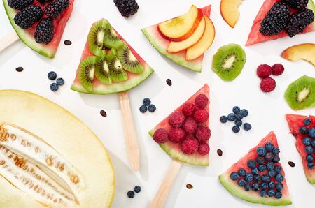 pattern with delicious watermelon on sticks with seasonal berries and fruits 写真素材 - 130499119
