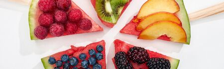 panoramic shot of delicious dessert with watermelon on sticks and berries on white background 写真素材 - 130506084