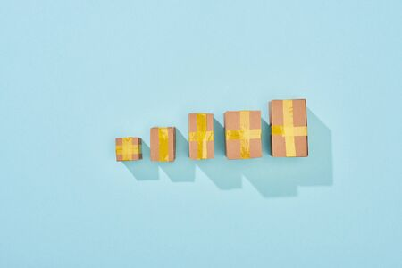 top view of closed cardboard boxes on blue background with copy space Stock Photo