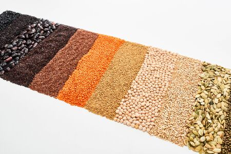 assorted black beans, rice, quinoa, buckwheat, chickpea, pumpkin seeds and red lentil isolated on white
