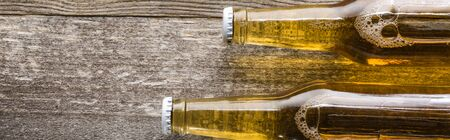 top view of beer in bottles on wooden background, panoramic shot Stock Photo
