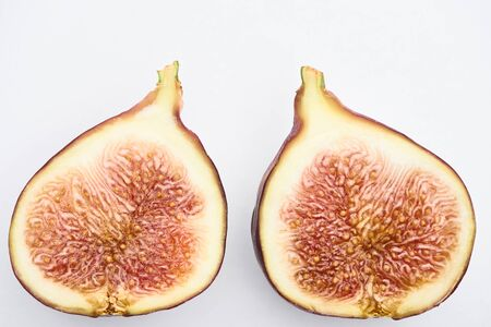 ripe delicious fig halves on white background