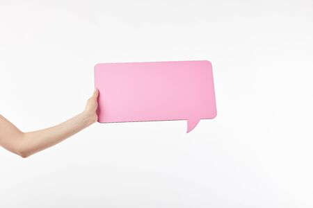 cropped view of woman with pink speech bubble in hand isolated on white