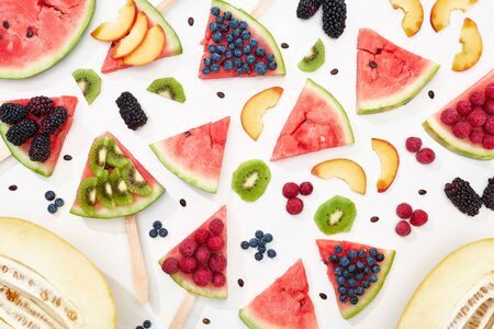 pattern with delicious ripe watermelon on sticks with seasonal berries and fruits