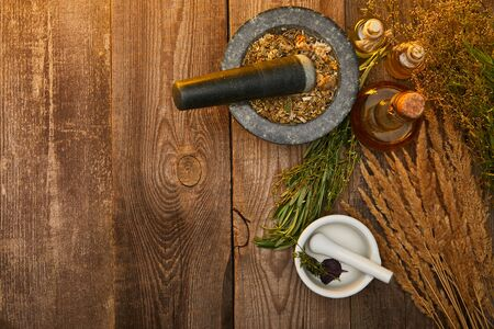 top view of mortars with pestles near fresh herbs on wooden surface with copy space Stok Fotoğraf