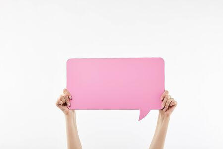 cropped view of woman with pink speech bubble in hands isolated on white